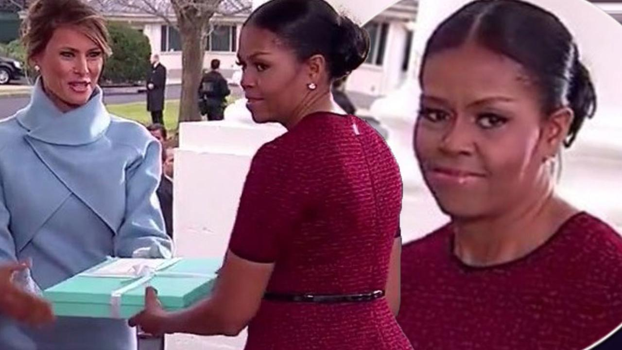 Michelle Obama looks flustered as Melania Trump gives her a gift