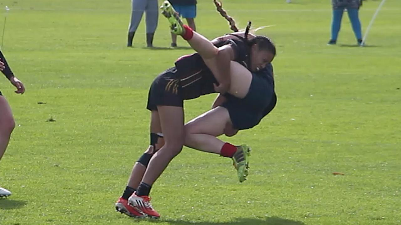 NZ Schoolgirl delivers cracking textbook dump tackle